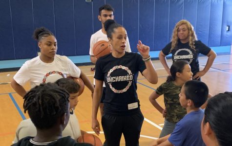 San Diego State women's basketball assistant coach Ciara Carl instructs kids during an Unchained event.