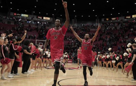 Sophomore forward Nathan Mensah (left) and senior guard KJ Feagin (right) head back to their locker room after defeating San José State 59-57 on Dec. 9 at Viejas Arena.