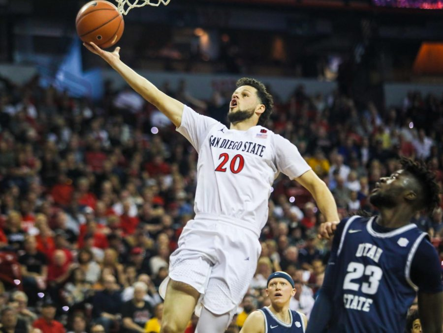 Junior guard Jordan Schakel attempts to lay the ball up during the Aztecs' 59-56 loss against Utah State at Thomas and Mack Center on March 7.