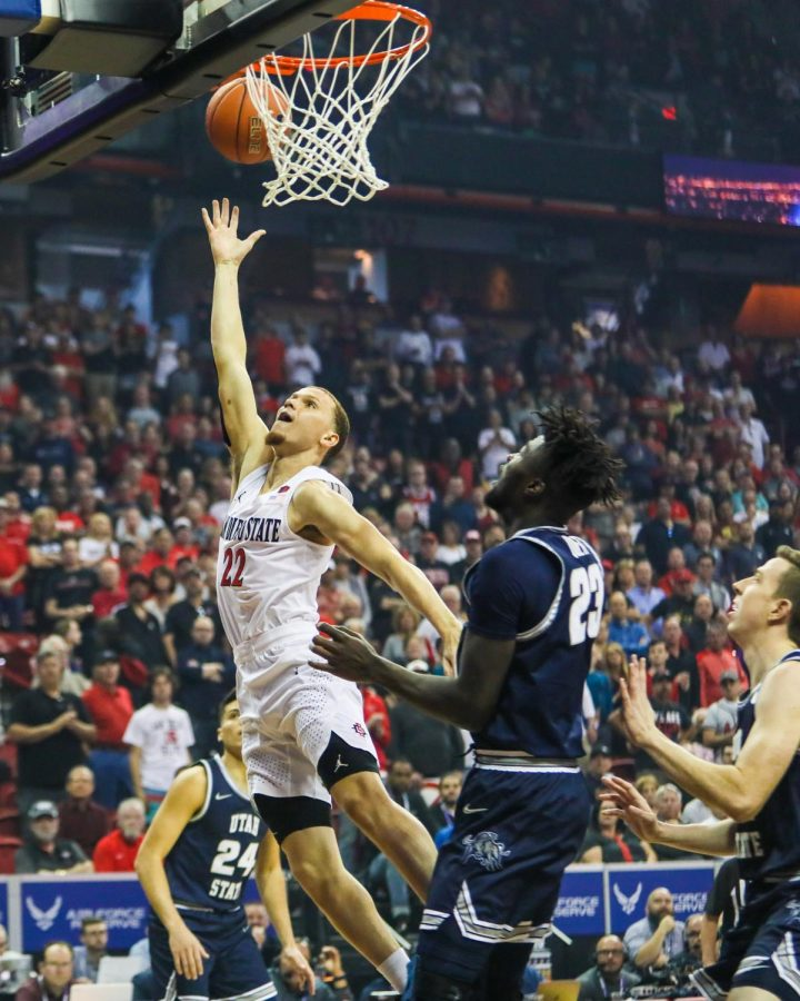 Then-junior guard Malachi Flynn lays the ball up during the Aztecs' 59-56 loss against Utah State at Thomas and Mack Center on March 7.