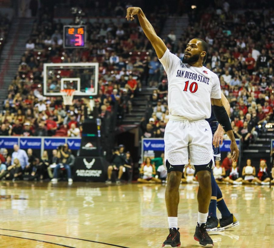 Senior guard KJ Feagin attempts a 3-pointer during the Aztecs' 59-56 loss against Utah State at Thomas and Mack Center on March 7.