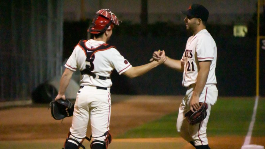 Sophomore+catcher+Wyatt+Hendrie+%28left%29+and+sophomore+pitcher+Brian+Leonhardt+%28right%29+congratulate+each+other+during+the+Aztecs%27+4-1+win+over+Iowa+on+Feb.+21+at+Tony+Gwynn+Stadium.