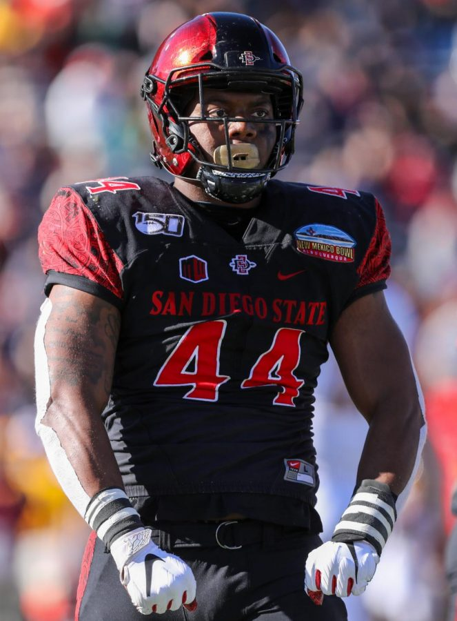 Then-senior+linebacker+Kyahva+Tezino+flexes+after+making+a+play+during+the+Aztecs%27+48-11+win+over+Central+Michigan+in+the+New+Mexico+Bowl+in+Albuquerque%2C+New+Mexico+on+Dec.+21%2C+2019.