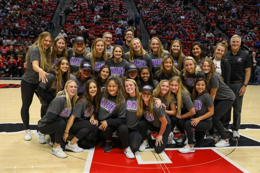 The Aztec swimming and diving team was honored during halftime at a men's basketball game for winning back-to-back Mountain West titles.