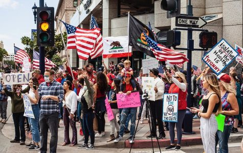 Protestors gather in Downtown San Diego in opposition to California Governor Gavin Newsom's stay-at-home order on April 18. The protest persisted despite local regulations limiting large gatherings.