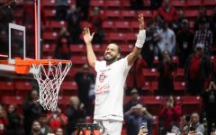 Senior guard KJ Feagin celebrates before cutting down a piece of the net after the Aztecs'  82-59 win over New Mexico on Feb. 11 at Viejas Arena. With the victory, SDSU claimed the Mountain West Conference regular-season title.