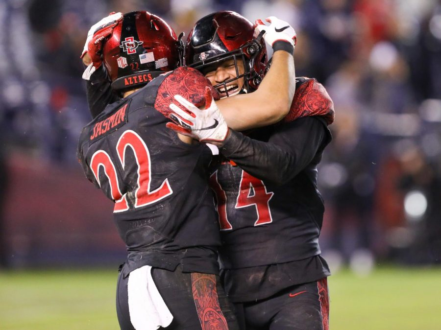 Then-junior+defensive+back+Tariq+Thompson+and+then-junior+running+back+Chase+Jasmin+celebrate+after+a+play+during+SDSU%27s+13-3+victory+over+BYU+on+Nov.+30+at+SDCCU+Stadium.