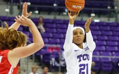 Former TCU guard Alex Crain shoots the ball over a defender.