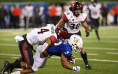 Fans will have to wait a few weeks longer to watch the San Diego State football team. That includes senior defensive back Tariq Thompson (pictured tackling a San José State player during the Aztecs' 27-17 win over the Spartans on October 19, 2019 in San José, California). Thompson received a preseason honor from the Mountain West Conference after he was named first team All-MW Defense.