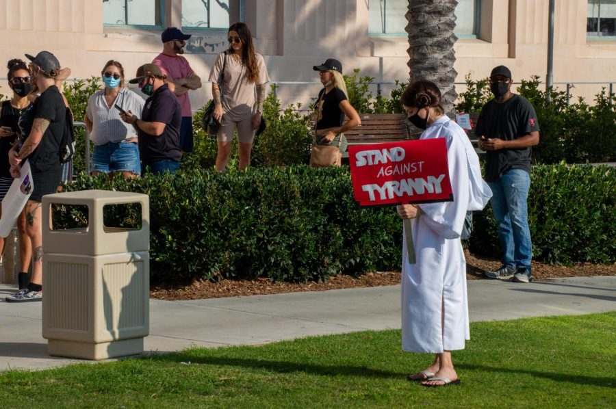 A San Diego county resident dressed as Princess Leia from Star Wars is against strict reopening guidelines.