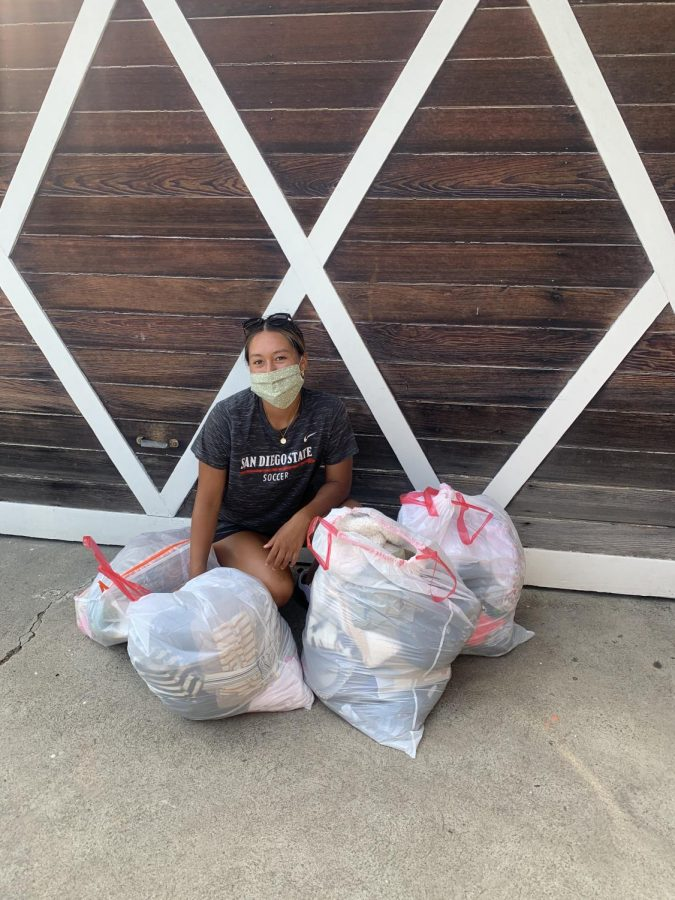 Womens soccer senior forward Veronica Avalos shown next to bags of clothes she donated to the nonprofit organization Unity 4 Orphans. Through the organization, the goods are delivered to children living in orphanages throughout Mexico and Latin America.