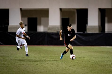 Then-freshman forward Hunter George dribbles the ball while being pursued by an Oregon State player during the Aztecs