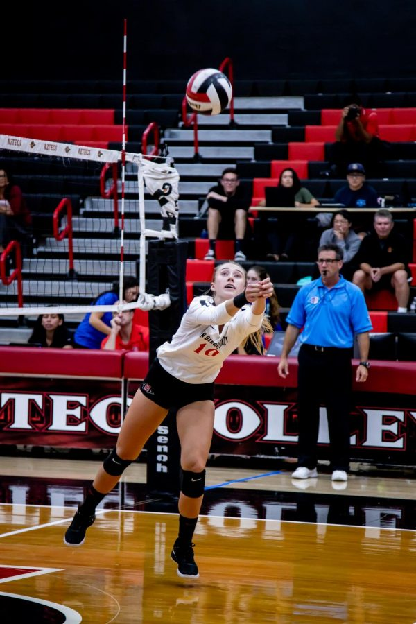 Then-sophomore setter Camryn Machado keeps the ball in play during the Aztecs' 3-2 win over San José State on Sept. 26, 2019 at Peterson Gym.