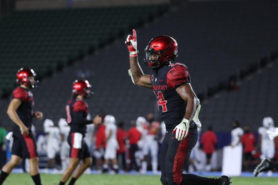 Senior running back Greg Bell points his finger to the sky after scoring a touchdown during the Aztecs' 34-6 win over UNLV on Oct. 24 at Dignity Health Sports Park in Carson, Calif. Bell finished the game with 111 rushing yards and a touchdown.
