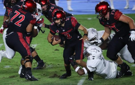 Sophomore quarterback Carson Baker attempts to escape a defender during the Aztecs' 34-6 win over UNLV on Oct. 24 at Dignity Health Sports Park in Carson, Calif.