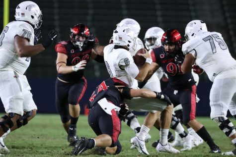 Junior linebacker Caden McDonald sacks UNLV quarterback in the Aztecs