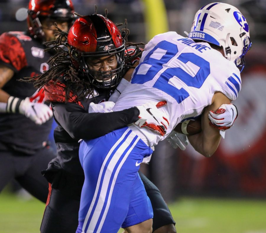 Then-junior safety Dwayne Johnson Jr. lays a hit on a BYU receiver during the Aztecs' 13-3 victory on Nov. 30, 2019 at SDCCU Stadium. With the help of former SDSU cornerback Ron Smith and his sister, Johnson Jr. started a GoFundMe page called the Building Connections Project Fund, assisting low-income families with online learning resources.