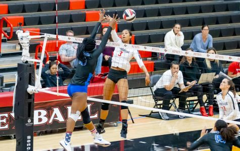 Then-sophomore middle blocker Andrea Walker spikes the ball during the Aztecs' 3-1 win over Air Force on Nov. 14, 2019 at Peterson Gym.