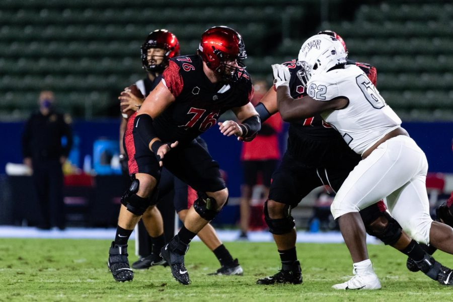 Senior offensive tackle Zach Thomas blocks a UNLV defender during the Aztecs' 34-6 win over the Runnin' Rebels on Oct. 24 at Dignity Health Sports Park in Carson, Calif.
