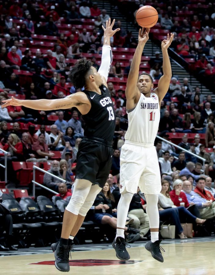 Then-junior+forward+Matt+Mitchell+fires+a+shot+over+a+Grand+Canyon+defender+during+the+Aztecs%27+86-61+win+over+the+Lopes+on+Nov.+13%2C+2019+at+Viejas+Arena.
