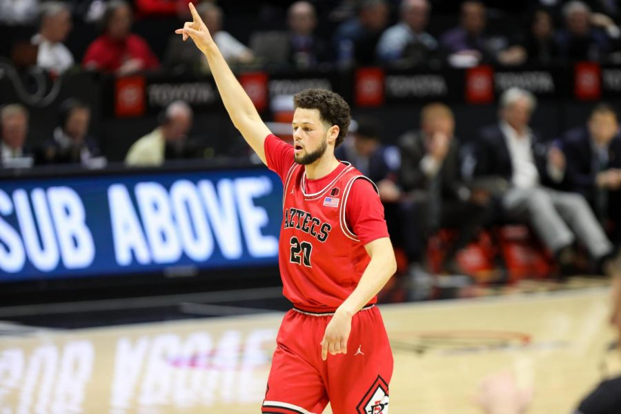 Then-junior guard Jordan Schakel points after a play during the Aztecs 68-55 win over Nevada on Jan. 18 at Viejas Arena.