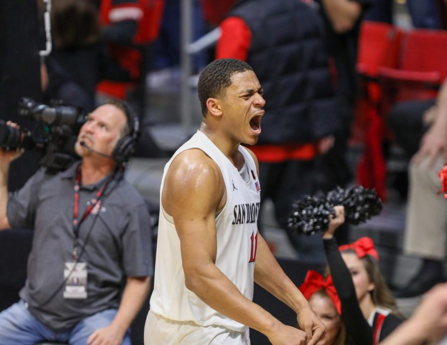 Then-junior forward Matt Mitchell celebrates after a play during the Aztecs' 82-59 win over New Mexico on Feb. 11 at Viejas Arena.