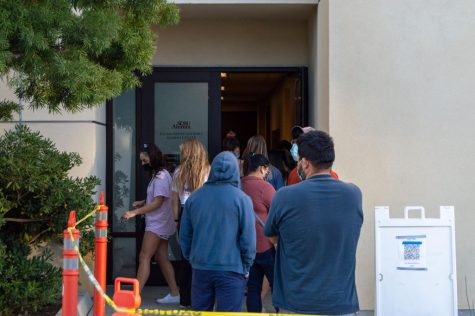 San Diego County residents and SDSU students wait in line to get tested at the county-operated COVID-19 testing center at the Parma Payne Goodall Alumni Center on Nov. 18.