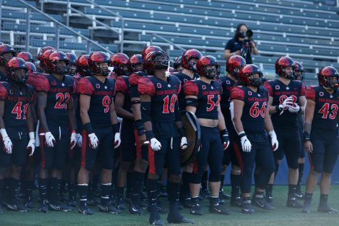 The SDSU football team looks to take the field before the Aztecs' 34-10 win over Hawaii on Nov. 14 at Dignity Health Sports Park in Carson, Calif.