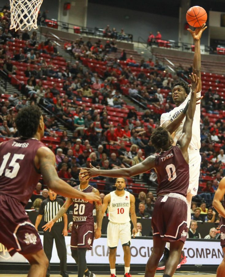 Then-sophomore forward Nathan Mensah attempts a shot over a Texas Southern defender during the Aztecs' 2019 season opener against the Tigers on Nov. 5 at Viejas Arena. The game resulted in a 77-42 SDSU victory.