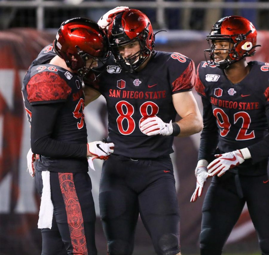 Then-sophomore tight end Daniel Bellinger (88) celebrates with then-sophomore wide reciever Elijah Kothe after Bellinger caught a touchdown pass during the Aztecs' 13-3 victory over Brigham Young on Nov. 30, 2019 at SDCCU Stadium.