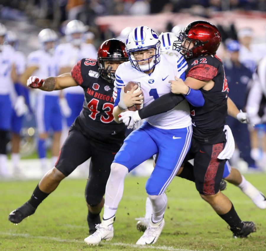 Brigham Young then-sophomore quarterback Zach Wilson is sacked by San Diego State then-senior linebacker Troy Cassidy (right) and then-sophomore linebacker Seyddrick Lakalaka during the Aztecs' 13-3 win over the Cougars on Nov. 30, 2019 at SDCCU Stadium.