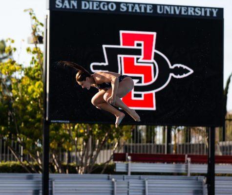 Senior diver Erica Sarver attempts a dive during the Aztecs