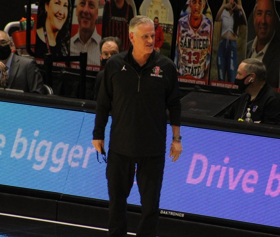 Men's basketball head coach Brian Dutcher talks to a referee during the Aztecs' 78-65 win over Colorado State on Jan. 4 at Viejas Arena.