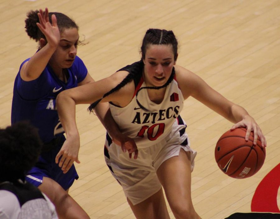 Sophomore guard Isabela Hernandez looks to dribble past an Air Force defender during the Aztecs' 58-55 loss to the Falcons on Jan. 24 at Viejas Arena.