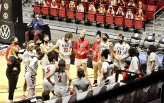 The San Diego State women's basketball team huddles around head coach Stacie Terry-Hutson during the Aztecs' 75-71 loss to Cal Baptist on Dec. 2, 2020 at Viejas Arena.