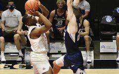 Freshman guard Lamont Butler goes up against a Brigham Young defender during the Aztecs' 72-62 loss to the Cougars on Dec. 18, 2020 at Viejas Arena.