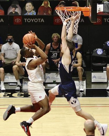 Freshman guard Lamont Butler goes up against a Brigham Young defender during the Aztecs