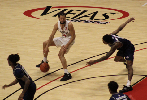 Senior guard Jordan Schakel attempts to dribble around a defender during the Aztecs' 65-60 win over Nevada on Jan. 7 at Viejas Arena.