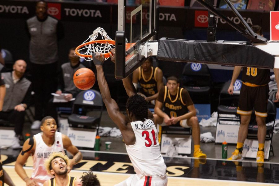 Junior forward Nathan Mensah slams it home during the Aztecs' 98-71 win over Wyoming on Jan. 31 at Viejas Arena.