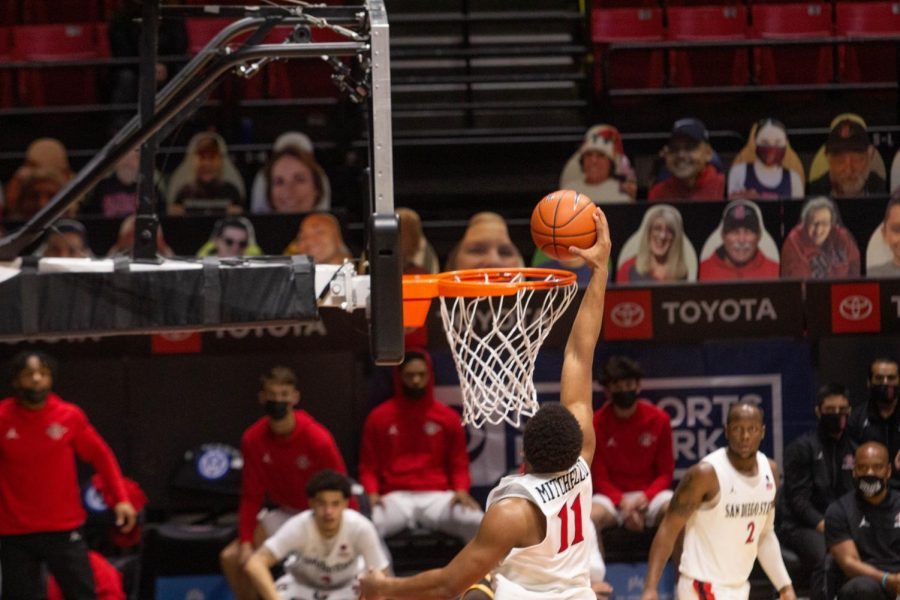 Senior forward Matt Mitchell attempts a dunk during the Aztecs' 98-71 win over Wyoming on Jan. 31 at Viejas Arena.