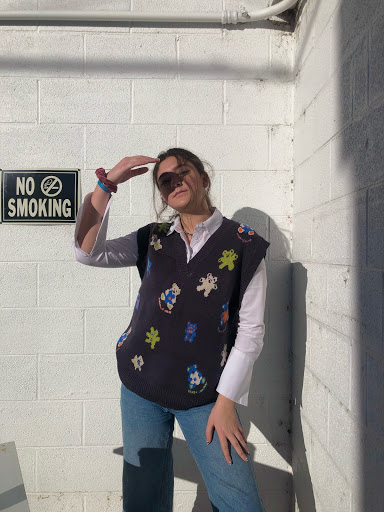 Anna Williams styled in a sweater vest and long sleeve button up combination (Photo credit: Anna Williams).