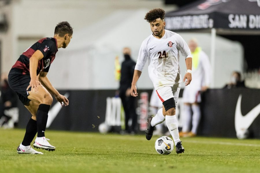 San Diego State men's soccer freshman defender Bryson Hankins faces a Stanford defender during the Aztecs' 1-0 loss to the Cardinal on Feb. 27 at the SDSU Sports Deck.