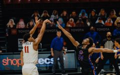 San Diego State mens basketball senior forward Matt Mitchell fires a 3-pointer during the Aztecs' 78-66 overtime win over Boise State on Feb. 25 at Viejas Arena.