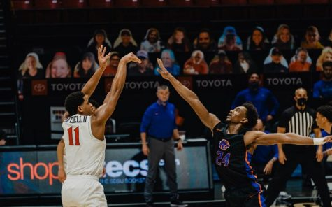 San Diego State mens basketball senior forward Matt Mitchell fires a 3-pointer during the Aztecs