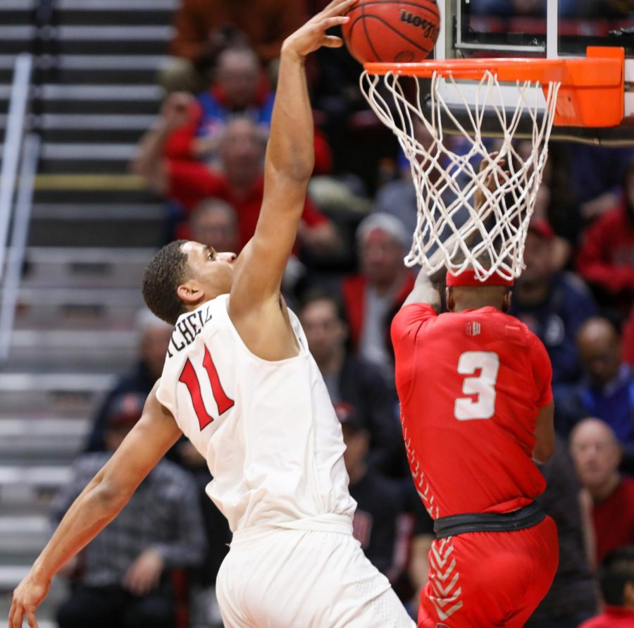 San Diego State men's basketball then-junior forward Matt Mitchell completes a dunk over a New Mexico defender during the Aztecs' 82-59 win over the Lobos on Feb. 11, 2020 at Viejas Arena. With the win, the Aztecs became the 2020 Mountain West regular-season champions.