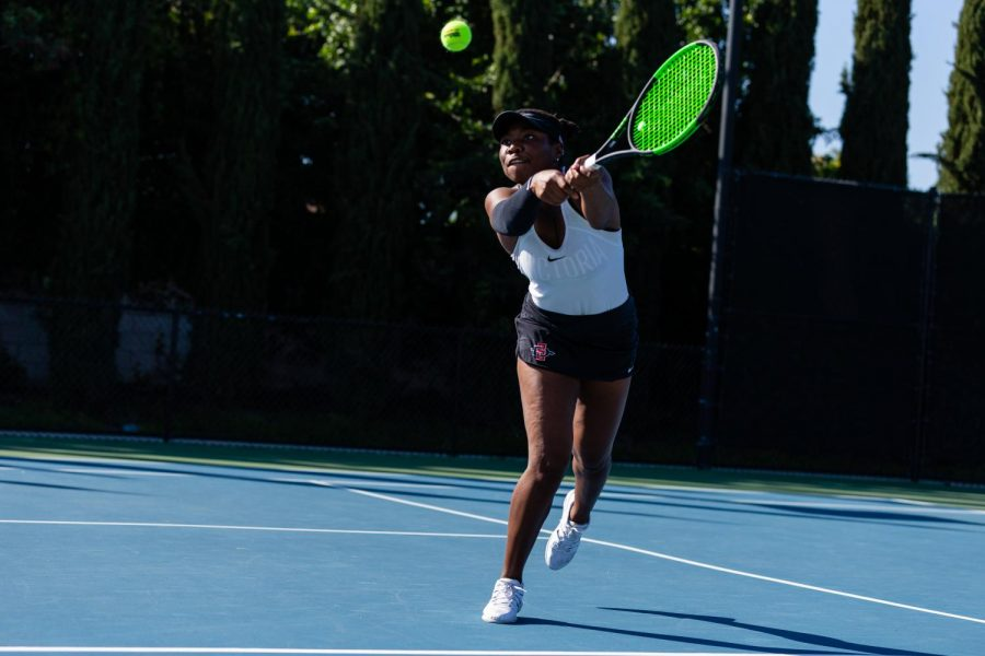 San Diego State women's tennis then-Nnena Nadozie swings at the ball during the Aztecs' 4-3 loss to Hawaii on Feb. 19, 2020 at the SDSU Tennis Center.