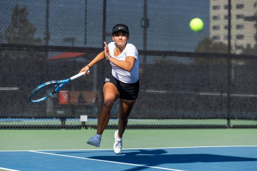 San Diego State women's tennis then-junior Tamara Arnold swings at the ball during the Aztecs' 4-3 loss to Hawaii on Feb. 19, 2020 at the SDSU Tennis Center.