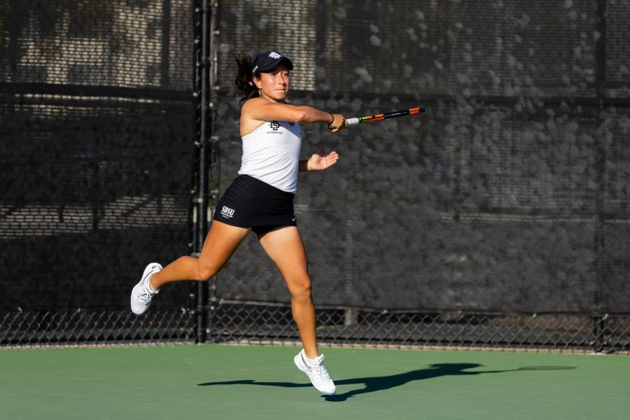 San Diego State women's tennis then-freshman Julia Jordan follows through on a swing during the Aztecs' 4-3 loss to Hawaii on Feb. 19, 2020 at the SDSU Tennis Center.