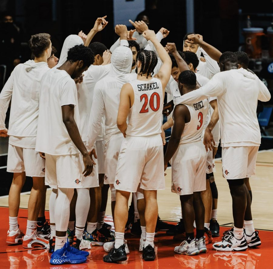 The San Diego State mens basketball team huddles together before the Aztecs 78-66 overtime win over Boise State on Feb. 25, 2021 at Viejas Arena.
