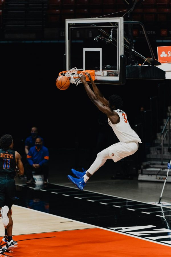 San Diego State men's basketball junior forward Nathan Mensah completes a two-handed slam dunk during the Aztecs' 78-66 overtime win over Boise State on Feb. 25, 2021 at Viejas Arena.